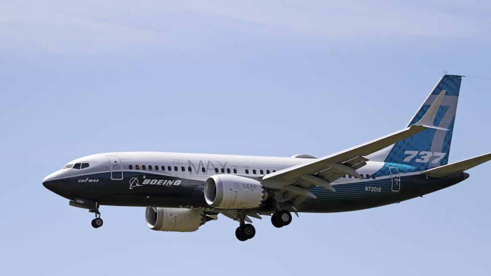 A Boeing 737 Max jet heading to a landing at Boeing Field following a test flight in Seattle.