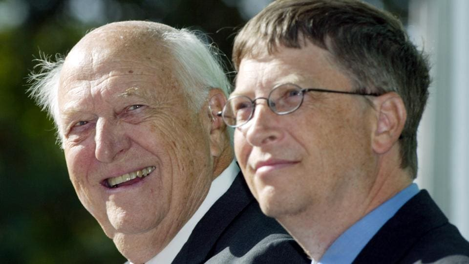 William H Gates Sr (left) smiles while sitting next to his son, Bill Gates.
