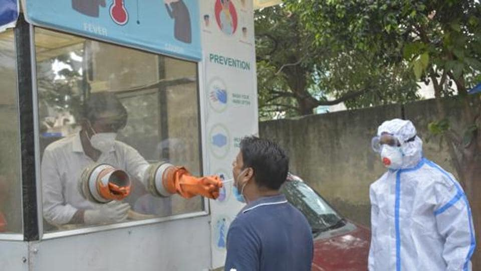 A health worker collects swab sample for coronavirus test in Ghaziabad, India, on September 15.