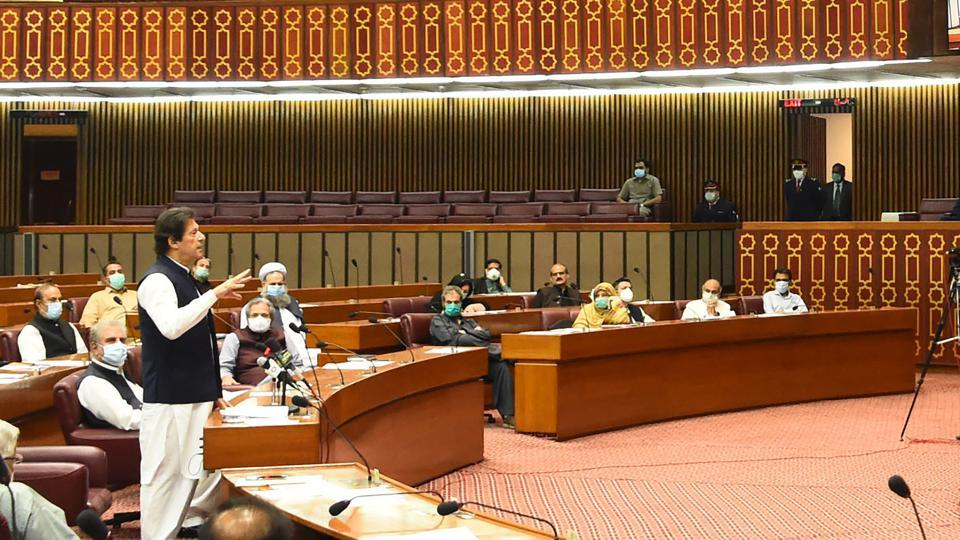 Pakistani Prime Minister Imran Khan addresses the parliament in Islamabad on June 25