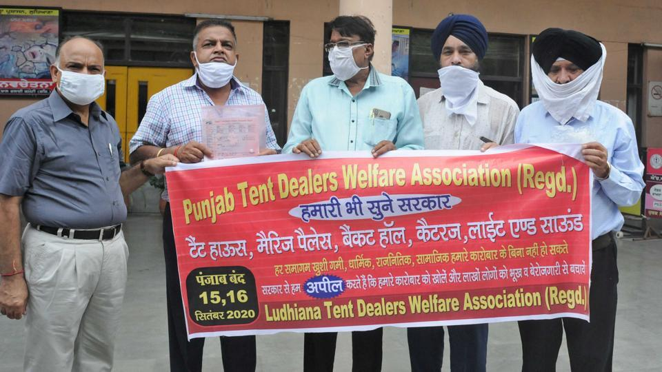 Members of tent dealers association protesting outside the DC office in Ludhiana, on Wednesday.