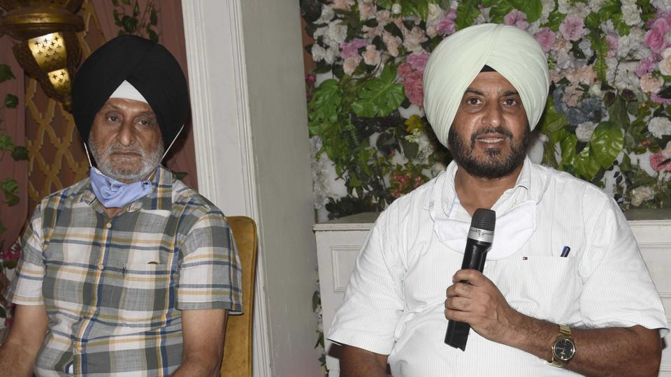 Former cricketer Bhupinder Singh Senior (right) addressing mediapersons in Ludhiana on Tuesday.