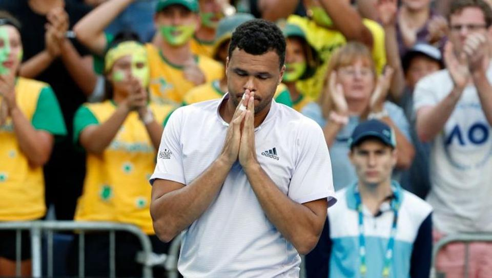 FILE PHOTO: Tennis - Australian Open - First Round - Melbourne Park, Melbourne, Australia - January 21, 2020. France's Jo-Wilfried Tsonga looks dejected after retiring from his match against Australia's Alexei Popyrin.