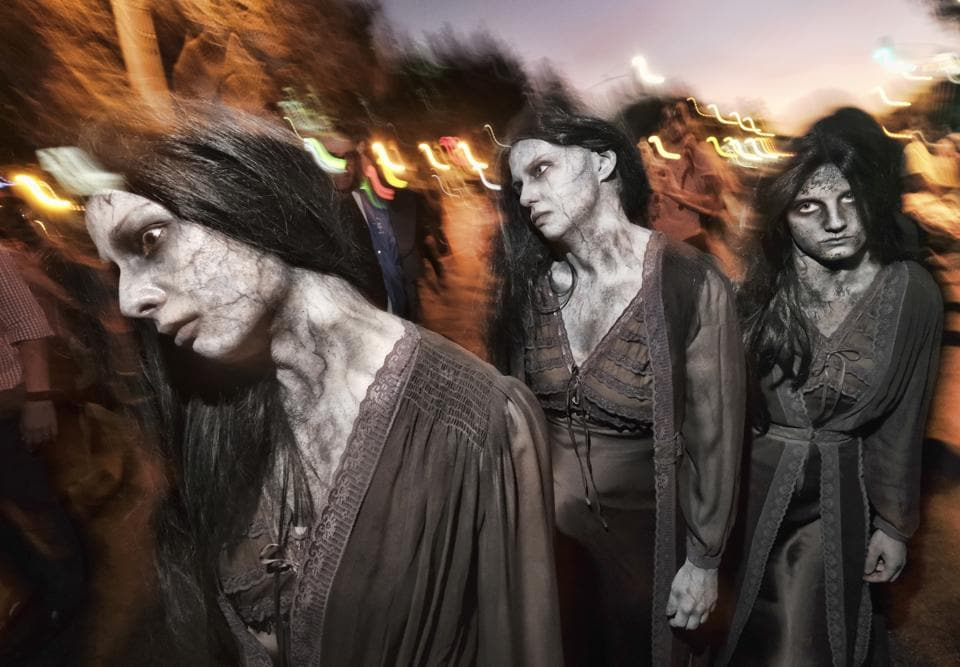 FILE - In this Oct. 31, 2018, file photo, zombie sisters manoeuvre their way down Santa Monica Boulevard in West Hollywood, Calif., during the West Hollywood Carnaval and Halloween Parade. The holiday so many look forward to each year is going to look different in the pandemic as parents and the people who provide Halloween fun navigate a myriad of restrictions and safety concerns. (Representational)