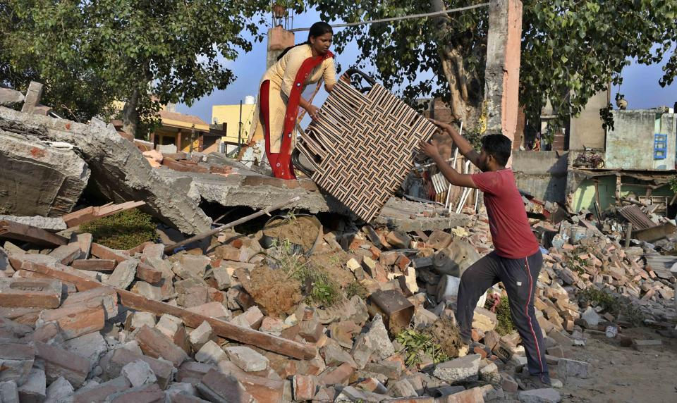 Residents gathering their belongings after their houses were razed during an anti-encroachment drive in New Vishwakarma Nagar, Ludhiana, on Wednesday.