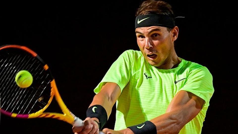 Rafael Nadal returns a shot.