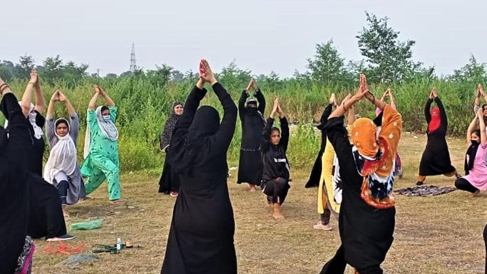 Women, many of them in burqa, practicing yoga in Haldwani town of Nainital district in Uttarakhand.
