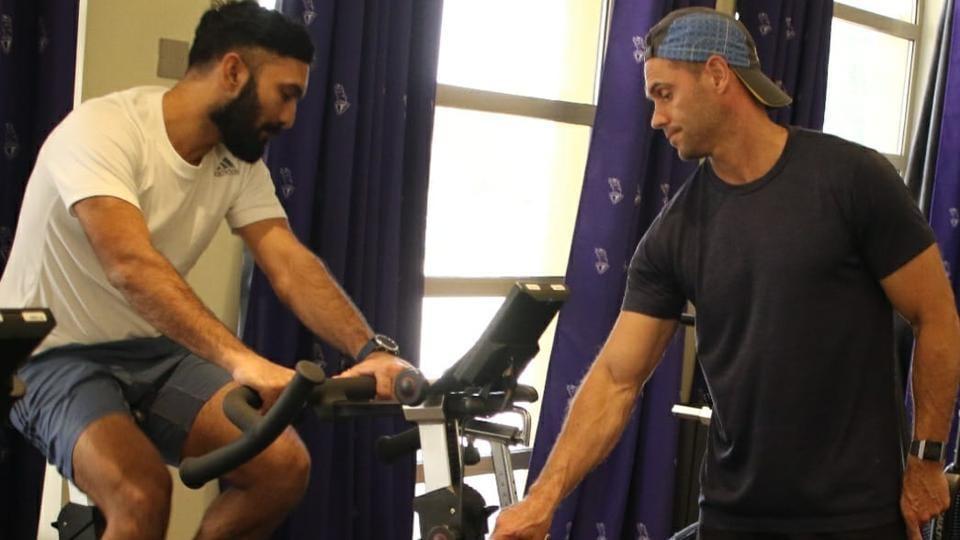 Chris Donaldson with KKR captain Dinesh Karthik