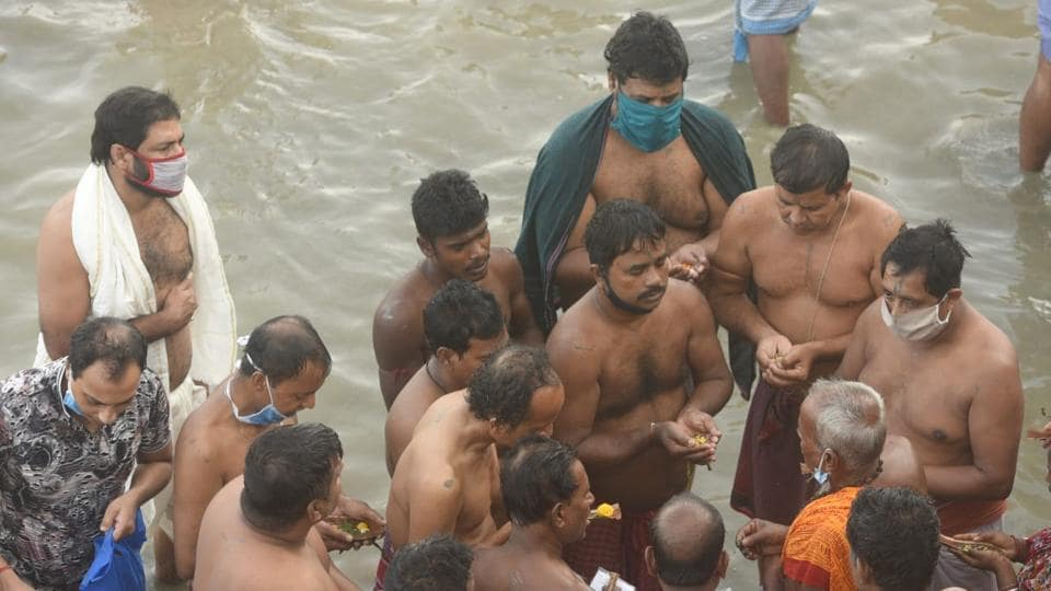 Thousands of people performed tarpan—a ritual offering prayers to departed ancestors on Mahalaya—at the ghats along River Hooghly.