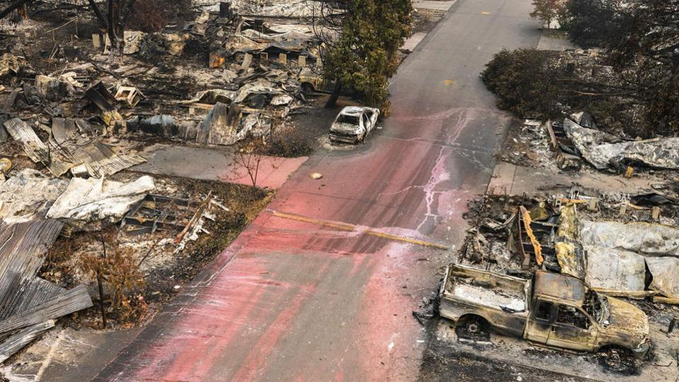 The remains of homes and vehicles line a residential street at Talent in Oregon on September 16. Fire Almeda which is said to have started in Ashland, south of Talent on the morning of September 8, spread 13 miles (20 kilometers) north after blowing for nearly a week.  (Nathan Howard / AFP)