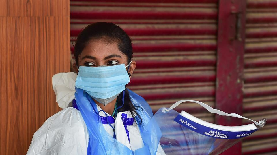 A medic waits for citizens at a Covid-19 test centre, Bangalore, September 17, 2020