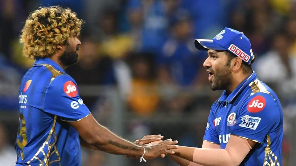 Mumbai Indians captain Rohit Sharma (R) celebrates with Lasith Malinga