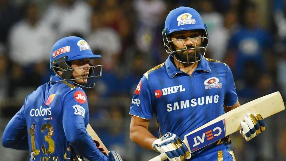 Mumbai Indians cricketers Quinton de Kock (L) and captain Rohit Sharma run between the wickets