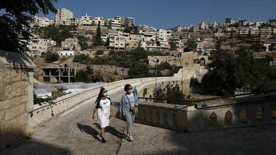Young Palestinian travel bloggers Malak Hasan and Bisan Alhajhasan arrive at the Convent of the Hortus Conclusus in Artas village near Bethlehem in the Israeli-occupied West Bank September 9, 2020.