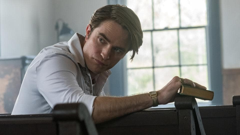 The Devil All the Time movie review: Robert Pattinson as Preston Teagardin  in a still from the new Netflix film.