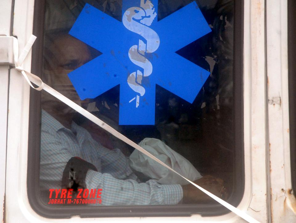 A Covid-19 patient being taken to the hospital in an ambulance at Bhangagarh in Guwahati.