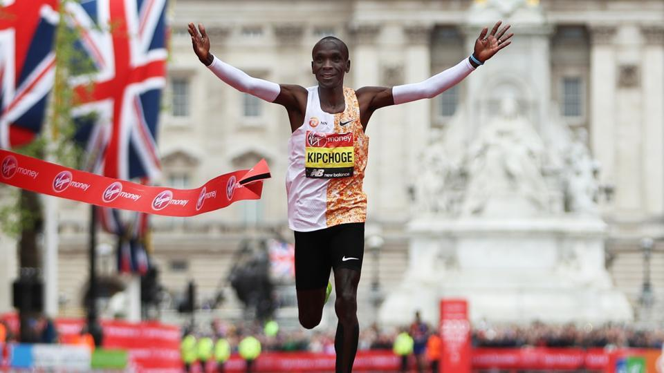 Eliud Kipchoge of Kenya crosses the finish line to win the Men's Elite race breaking the race record during the Virgin Money London Marathon in 2019.