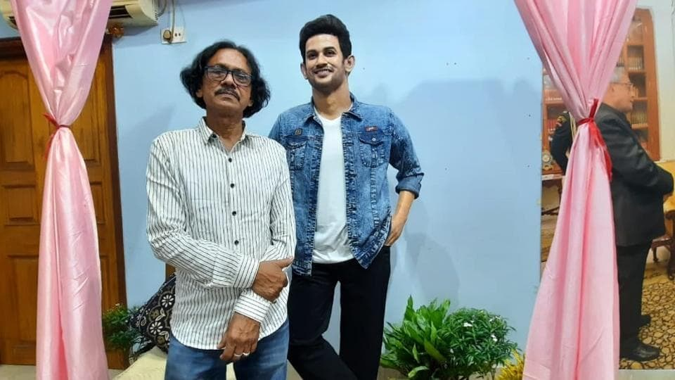 Sculptor Sukanto Roy with the wax statue of Sushant Singh Rajput.