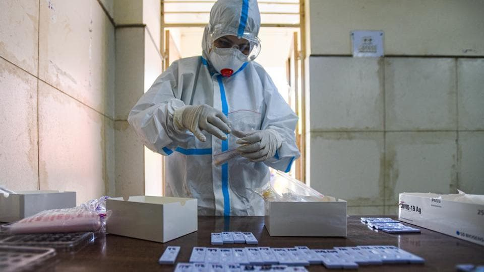 A medical professional in PPE coveralls preserves a swab sample collected to test for Covid-19 infection at Saket in New Delhi on September 16. India crossed the 60-million-mark for coronavirus disease (Covid-19) tests on September 16, HT reported. (Amal KS / HT Photo)