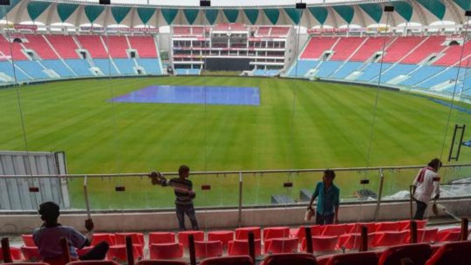 Workers clean a railing of Bharat Ratna Shri Atal Bihari Vajpayee Ekana Cricket Stadium (Representational image)