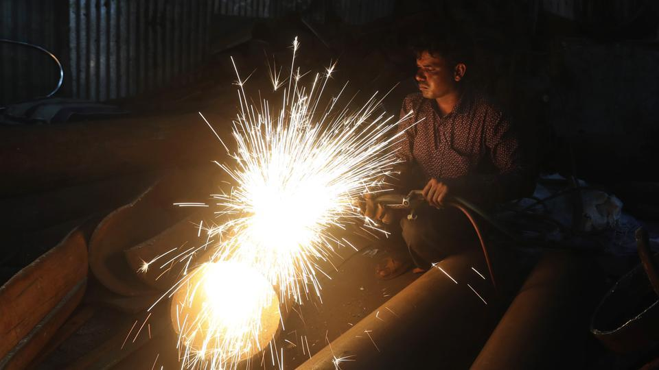 A worker welds an iron pipe at a shop in Mumbai. India's economy contracted by 23.9% in the April-June quarter, its worst performance in at least 24 years, as the coronavirus pandemic ravaged what was once the world's fastest growing major economy.