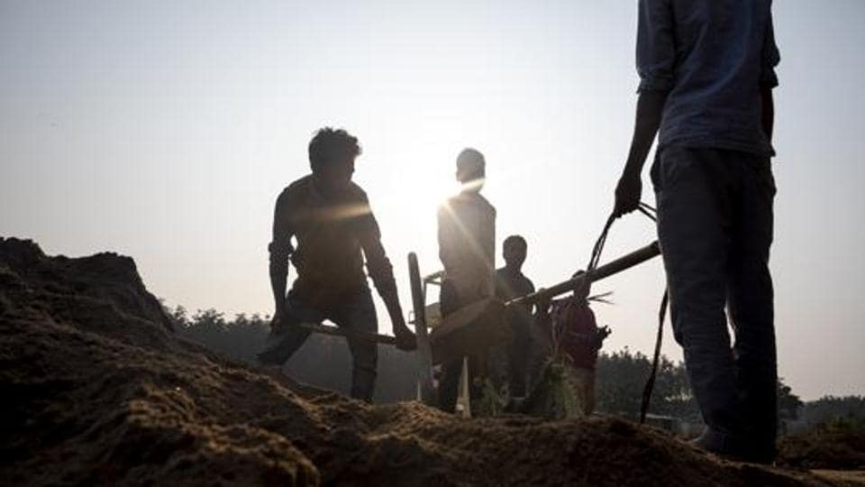 Workers at an under-construction detention centre in Matia, Assam, in January.