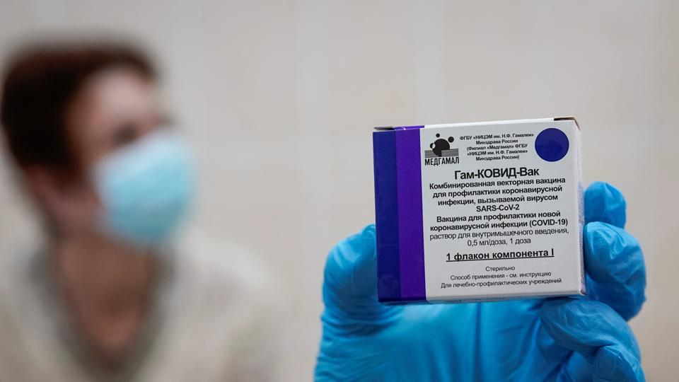 A nurse shows a box with Russia's Sputnik-V vaccine  prepared for inoculation in the post-registration trials stage at a clinic in Moscow, Russia.