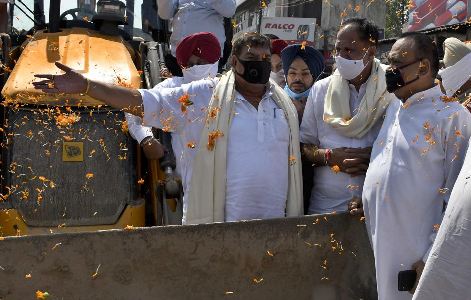 (From left to right) MLA Surinder Dawar, mayor Balkar Sandhu and municipal commissioner Pradeep Sabharwal inaugurating the project to cover the open drain  opposite Shingar Cinema in Ludhiana on Friday.