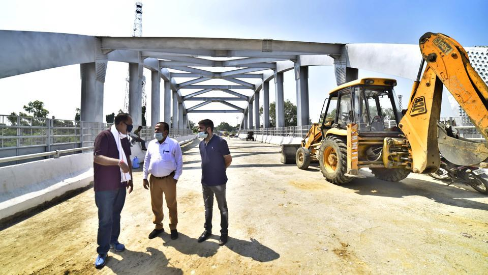 Mayor Balkar Singh Sandhu and MC officials inspecting the progress of the Jagraon Bridge repair work in Ludhiana on Wednesday.