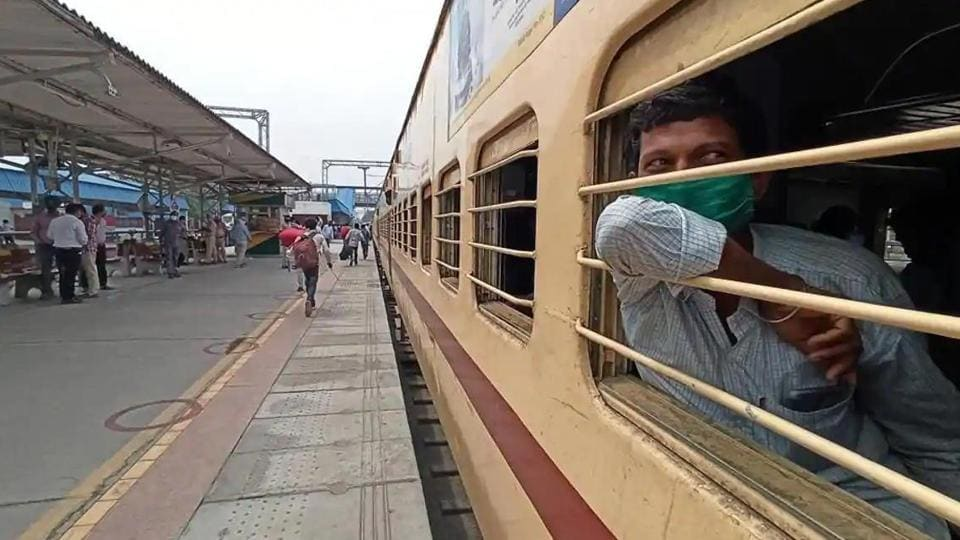 Migrant workers leave Bathinda railway station onboard the special 'Shramik' train to Bihar, during Covid-19 lockdown.