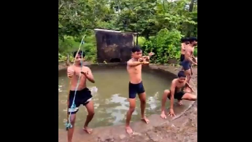 The reverse video shows the men coming out of a small waterbody, one by one.