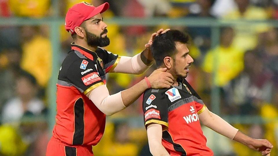 RCB bowler Yuzvendra Chahal and Virat Kohli celebrate after claiming the wicket of CSK batsman Ambati Rayudu during the Indian Premier League 2019 (IPL T20).