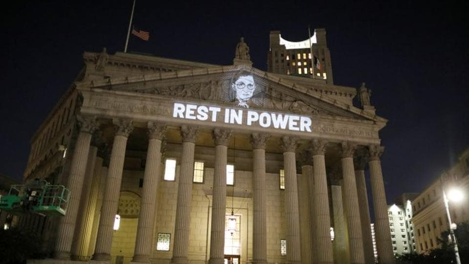 An image of Associate Justice of the Supreme Court of the United States Ruth Bader Ginsburg is projected onto the New York State Civil Supreme Court building in Manhattan, New York City, US.
