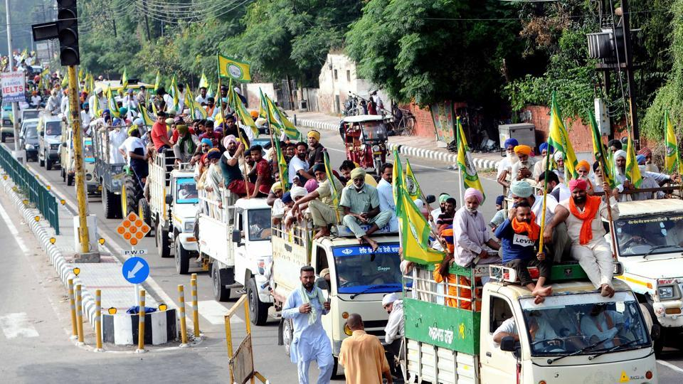 Members of various farmers' organisations arrive by vans on the fifth day of their protest over agriculture related ordinances in Patiala, Punjab.