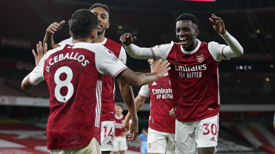 Arsenal's Eddie Nketiah, right, celebrates scoring his side's second goal during the English Premier League.