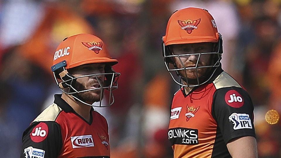 Sunrisers Hyderabad's David Warner, left, and Jonny Bairstow talk between the wickets against Royal Challengers Bangalore during the IPL T20 cricket match in Hyderabad.
