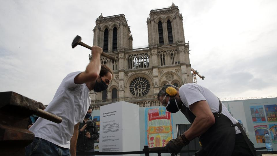 Blacksmiths and carpenters put the skills of their Medieval colleagues on show on the plaza in front of Notre Dame Cathedral in Paris.