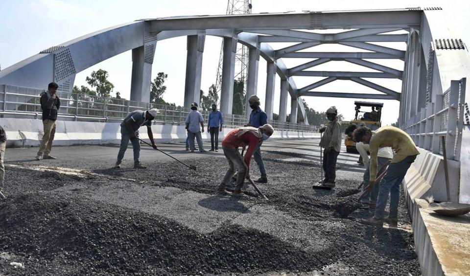 Construction work in full swing at Jagraon Bridge in Ludhiana on Sunday.