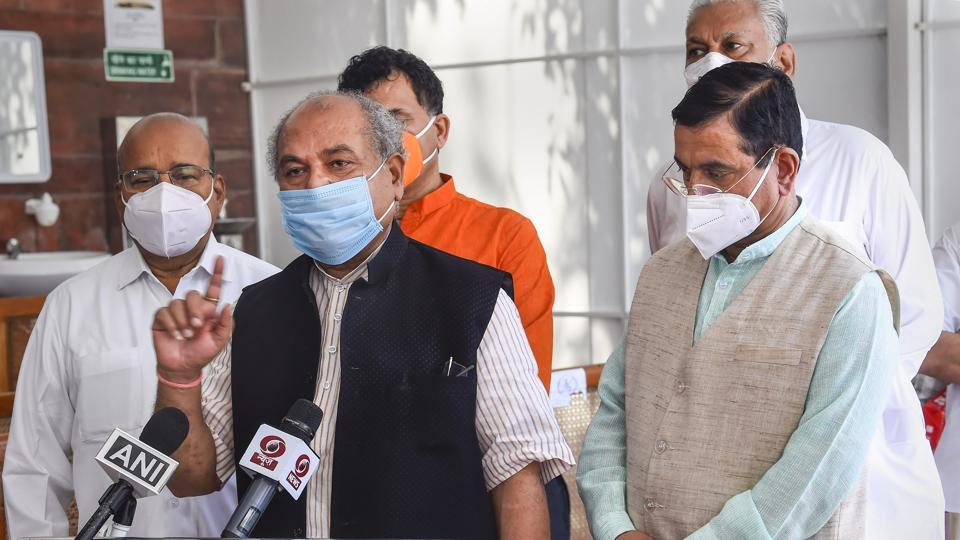 New Delhi: Union Minister Narendra Singh Tomar flanked by Union Ministers Thawar Chand Gehlot and Pralhad Joshi addresses the media after the passing of two farm bills in the Rajya Sabha during the ongoing Monsoon Session, at Parliament House in New Delhi