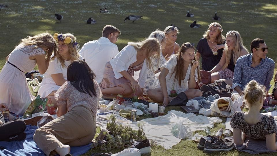 People picnic during the annual Midsummer celebrations in Stockholm, Sweden. Sweden's relatively low-key approach to coronavirus lockdowns captured the world's attention when the pandemic first hit Europe.