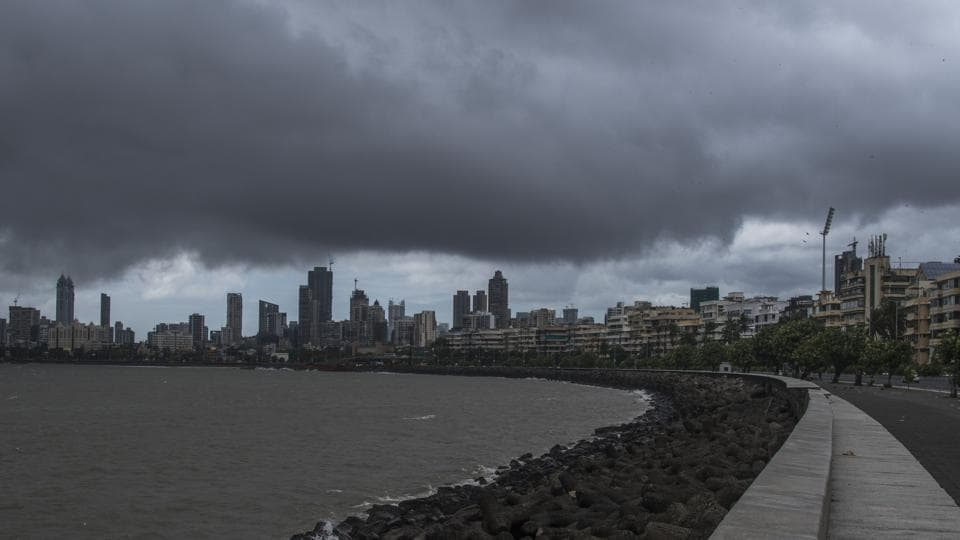 Dark rain clouds over the skyline seen from Marine Drive in Mumbai.