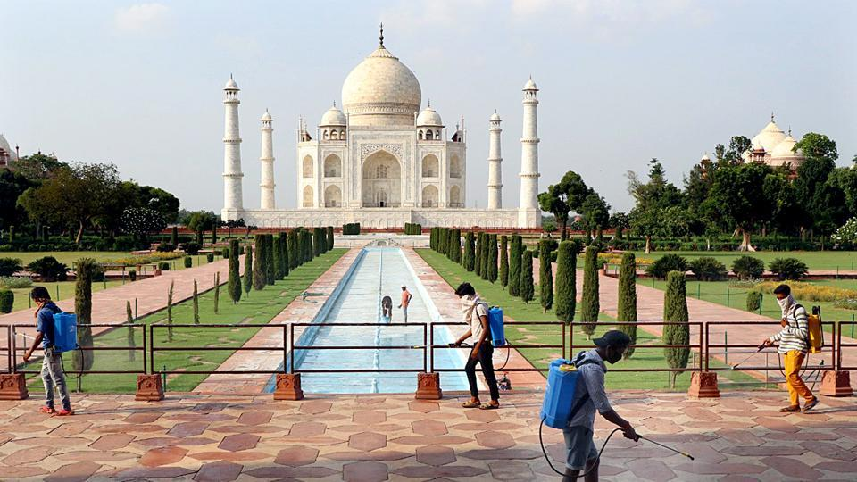 Workers disinfect the Taj Mahal premises ahead of the monument's reopening on Monday.