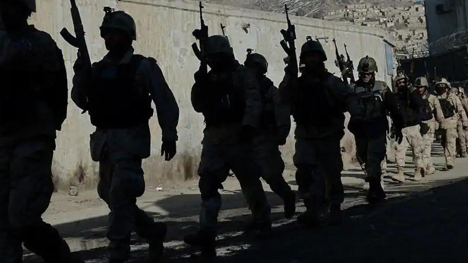 In this file photo, Afghan commandos walk down a road near the Kabul police headquarters.(AFP)