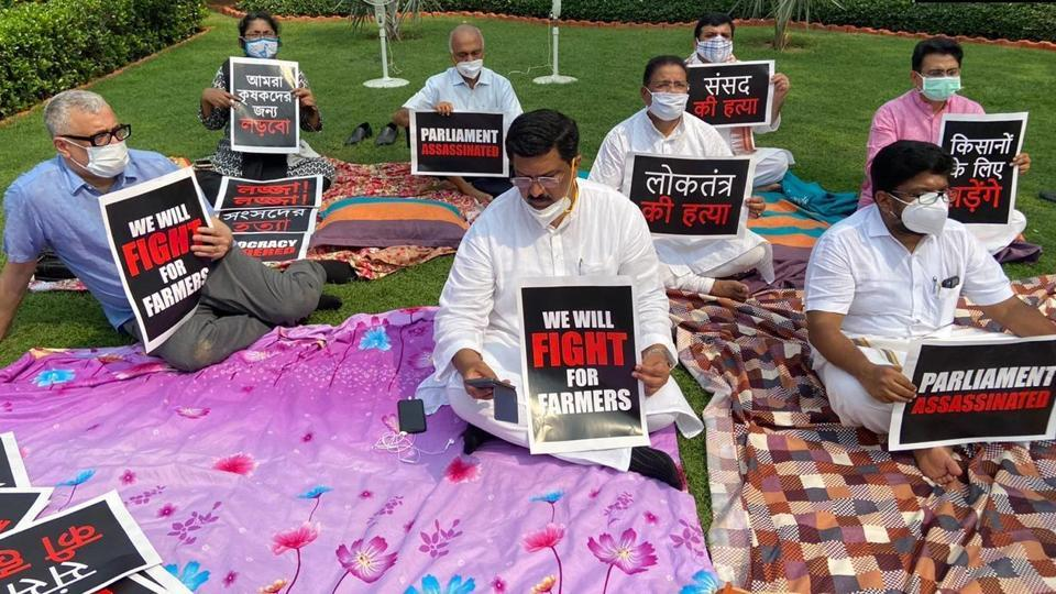 The eight suspended Rajya Sabha MPs stage protest in Parliament premises on Monday.