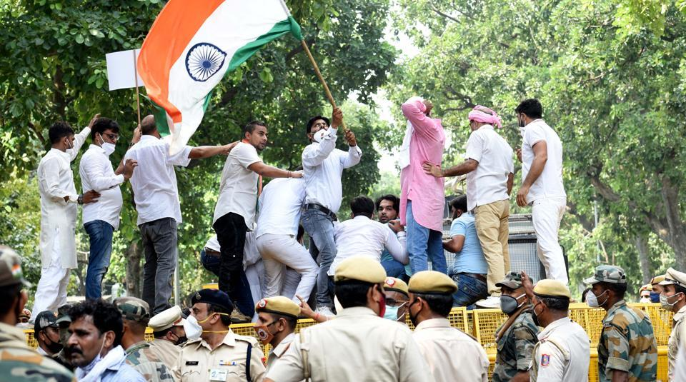 Delhi Pradesh Congress workers during a demonstration against agriculture related reform bills, near Shastri Bhawan in New Delhi on Monday.