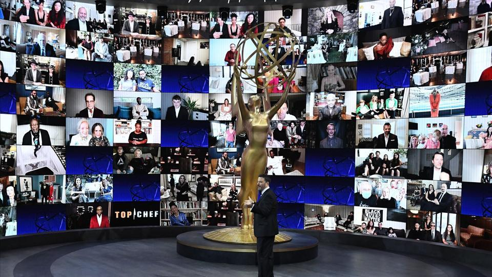 Host Jimmy Kimmel in front of a wall of nominees watching remotely at the Staples Center in Los Angeles during the 72nd Primetime Emmy Awards ceremony on September 20. The ceremony, which was forced to make major changes due to the coronavirus pandemic, brought Hollywood television stars together, distantly, through a giant Zoom call. (Image Group LA / American Broadcasting Companies, Inc. / ABC / AFP)