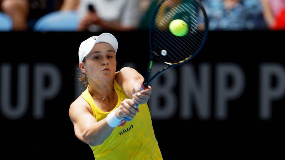 Australia's Ash Barty returns to France's Caroline Garcia during Fed Cup.