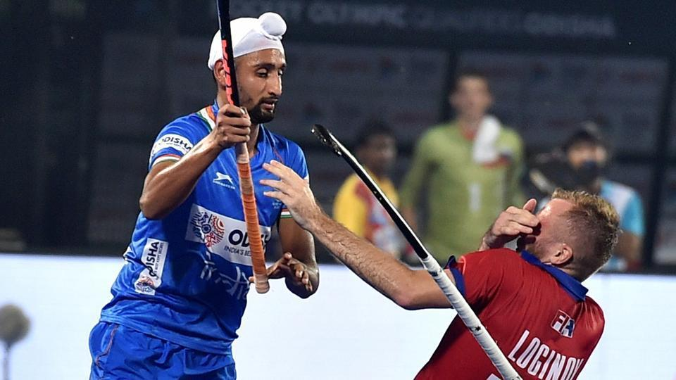 Indian player Mandeep Singh (11) tussle with Laroslav Loginov (19) of Russia during FIH Hockey Olympic Qualifiers 2019.