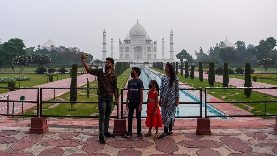The Taj Mahal reopened to visitors on September 21 in a symbolic business-as-usual gesture even as India looks set to overtake the US as the global leader in coronavirus infections. The monument was closed on March 17 after all heritage monuments protected under the Archaeological Survey of India (ASI)  stopped public admission under the union ministry of culture's directives. (Sajjad Hussain / AFP)