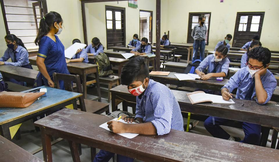 Students maintain social distancing as they attend a class, after schools and colleges re-opened in Assam during Unlock 4, at Angelika Higher Secondary School in Guwahati, Monday, Sept. 21, 2020. (PTI Photo)